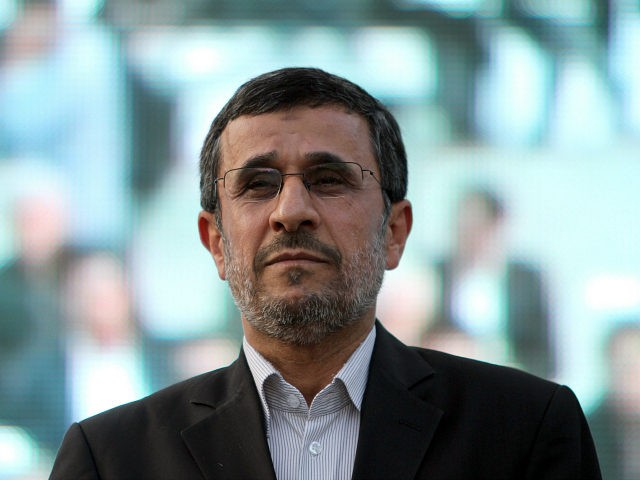 IRAN, Tehran : Iranian outgoing President Mahmoud Ahmadinejad is seen during a ceremony at Tehran's Golestan Palace celebrating its inscription on the UNESCO World Heritage List on July 7, 2013. The palace, built in the 16th century, is a masterpiece of the art of the Qajar period. AFP PHOTO/ATTA KENARE