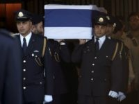 Members of the Israeli Knesset guard carry the coffin of former Israeli president Shimon Peres at the Knesset, Israel's Parliament, in Jerusalem on September 29, 2016. The body of Shimon Peres was lying in state outside Israel's parliament as the world pays tribute to a statesman whose funeral is expected to draw leaders from around the globe. The ex-president died on September 28, 2016 at the age of 93 after suffering a stroke. / AFP / GALI TIBBON (Photo credit should read GALI TIBBON/AFP/Getty Images)