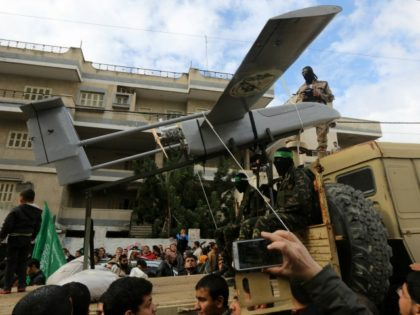 Palestinian militants of the Ezzedine al-Qassam Brigades, Hamas' armed wing, dislpay a drone during a parade marking the 27th anniversary of the Islamist movements creation on December 14, 2014 in Gaza City. AFP PHOTO / MAHMUD HAMS (Photo credit should read MAHMUD HAMS/AFP/Getty Images)