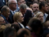 New York City Mayor Bill de Blasio speaks to US Democratic presidential nominee Hillary Clinton during a memorial service at the National 9/11 Memorial September 11, 2016 in New York. The United States on Sunday commemorated the 15th anniversary of the 9/11 attacks. / AFP / Brendan Smialowski (Photo credit …
