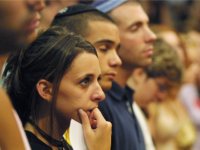 JERUSALEM - AUGUST 12: Foreign students cry during a ceremony to honor victims of an explosion at a Hebrew University cafeteria, organized by The International School for Overseas Students August 12, 2002 in Jerusalem, Israel. The July 31, 2002 bomb blast killed eight people, including five American citizens. (Photo by Quique Kierszenbaum/Getty Images)