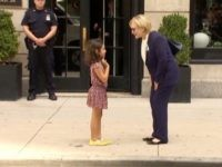 U.S. Democratic presidential nominee Hillary Clinton greets a girl on the sidewalk after leaving her daughter Chelsea's home in New York, U.S. September 11, 2016 in this still image taken from video. REUTERS/via Reuters TV