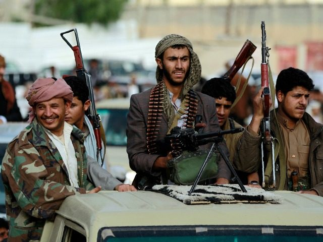Armed tribesmen, loyal to the Shiite Houthi rebels, stand in the back of a vehicle as they attend a gathering in the capital Sanaa to mobilize more fighters to battlefronts to fight pro-government forces in several Yemeni cities, on June 20, 2016. The Shiite Huthi rebels and their allies overran …