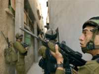 In this photo distributed by the Israeli Defense Forces, Israeli soldiers search for wanted Palestinian militants May 24, 2003 in the West Bank Palestinian town of Tulkarem. Several Palestinians were detained in the raid as well as a few volunteers with the pro-Palestinian International Solidarity Movement. (Photo by Tzvika Golan/IDF/Getty Images)