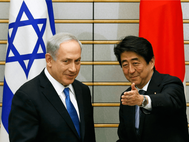 Israel's Prime Minister Benjamin Netanyahu (L) meets with Japan's Prime Minister Shinzo Abe at the start of their meeting at the prime minister's official residence in Tokyo on May 12, 2014. AFP PHOTO / POOL / Toru Hanai (Photo credit should read TORU HANAI/AFP/Getty Images)