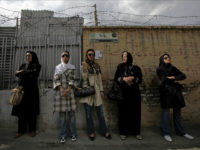 Iranian women wait in line outside a polling station during the Iranian presidential election in Tehran, in this June 12, 2009 file photo. REUTERS/Ahmed Jadallah/Files