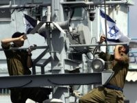 Israeli sailors raise the national and navy flags as they ready to go out on patrol on the 'Devora' gunship from their base in the portal city of Haifa, 26 March 2006. The gunship is going out on a patrol along the Israeli Mediterranean coast. AFP PHOTO/MENAHEM KAHANA (Photo credit …