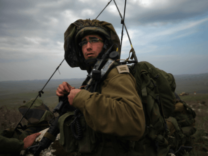 GOLAN HEIGHTS - DECEMBER 10: Israeli army paratroopers advance as their brigade completes a week-long live-fire training exercise December 10, 2009 on the Golan Heights. The Israeli Knesset approved yesterday the first readings of a bill that would require a referendum on any withdrawal from sovereign Israeli territory, such as …