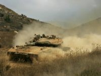 An Israeli tank arrives at the Israel-Lebanon border from south Lebanon, 20 August 2006. A fragile truce to end a month-long war in Lebanon was facing its biggest test today after an Israeli commando raid against Hezbollah which UN chief Kofi Annan charged was a violation of the ceasefire deal. AFP PHOTO/GALI TIBBON (Photo credit should read GALI TIBBON/AFP/Getty Images)