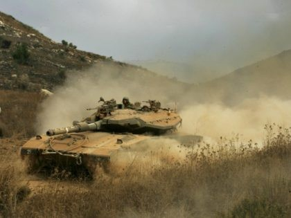 An Israeli tank arrives at the Israel-Lebanon border from south Lebanon, 20 August 2006. A fragile truce to end a month-long war in Lebanon was facing its biggest test today after an Israeli commando raid against Hezbollah which UN chief Kofi Annan charged was a violation of the ceasefire deal. …