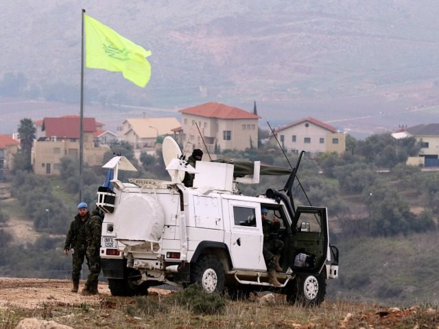 Soldier of the United Nations Interim Forces in Lebanon (UNIFIL) monitor the area in the Lebanese town of Marjayoun on border with Israel, as the Israeli village of Mutella is seen in the background, on January 5, 2016, one day after the Israeli army shelled the area in retaliation to …