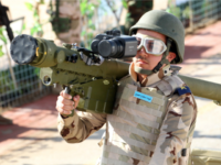 members of the Iraqi army carries a man-portable air-defence system (MANPAD) as he stands on a vehicle during a yearly military parade on February 1, 2015 in the capital Baghdad. Violence in Iraq killed 1,375 people in January, month eight of the battle against jihadists who swept through large areas …