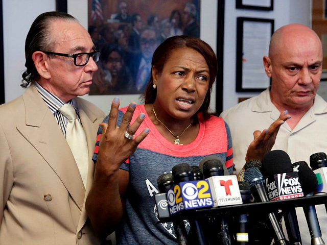 Maribel Martinez, accompanied by her attorney Sanford Rubenstein, left, and a translator, speaks at a news conference at her attorney's office, in the Brooklyn borough of New York, Thursday, Sept. 1, 2016. Martinez says she hasn't stopped crying since JetBlue airlines mistook her son for another child and flew him to the wrong city. (AP Photo/Richard Drew)