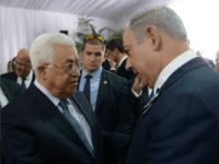 In this handout photo provided by the Israel Government Press Office (GPO), Israeli Prime Minister Benjamin Netanyahu shakes hands with Palestinian Authority President Mahmoud Abbas during the funeral of former Israeli leader Shimon Peres on September 30, 2016 in Jerusalem, Israel. World leaders and dignitaries from 70 countries attended the …
