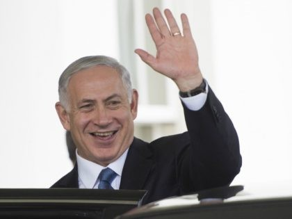 Israeli Prime Minister Benjamin Netanyahu waves after a bilateral meeting at the White House in Washington, DC, October 1, 2014. A skeptical Israeli Prime Minister Benjamin Netanyahu on Wednesday directly warned President Barack Obama not to accept any Iran deal that would allow Tehran to become a 'threshold nuclear power.' …