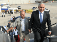 In this handout from the Israeli GPO, Israeli Prime Minister Benjamin Netanyahu walks up to his aircraft as he departs to Romania on July 6, 2011 in an unspecified city in, Israel. Netanyahu will meet with Romania's President Traian Basescu and Prime Minister Emil Boc. (Photo by Moshe Milner/GPO via …