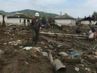 North Korea, Hoery?ng : In this handout photo taken on September 7, 2016 and released on September 13, 2016 by UNICEF DPRK a local representative of red cross (C left) surveys the damage to houses, caused by heavy flooding of the Tumen river along the road from Musan to Yonsa …