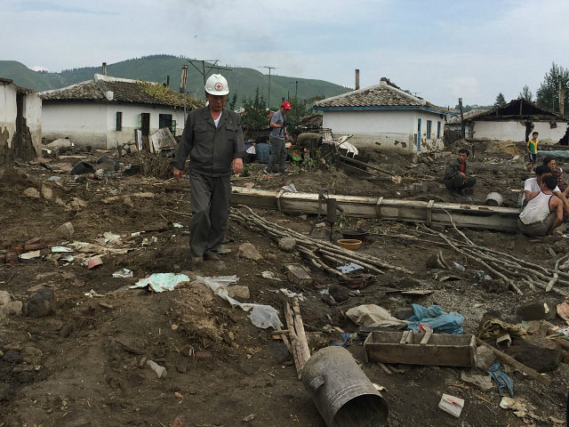 "North Korea, Hoery?ng : In this handout photo taken on September 7, 2016 and released on September 13, 2016 by UNICEF DPRK a local representative of red cross (C left) surveys the damage to houses, caused by heavy flooding of the Tumen river along the road from Musan to Yonsa in Hoery?ng, North Hamyong province. Rescue workers struggled to reach North Korea's flood-ravaged communities Tuesday as the Red Cross warned of a ""major and complex diaster"" which has killed scores and left tens of thousands in urgent need of help. At least 133 people have been killed and hundreds more are still missing after devastating floods hit the country's north, leaving tens of thousands homeless and destitute, with the risk of disease now looming. / AFP PHOTO / UNICEF DPRK / Murat SAHIN / - South Korea OUT / REPUBLIC OF KOREA OUT ---EDITORS NOTE--- RESTRICTED TO EDITORIAL USE - MANDATORY CREDIT ""AFP PHOTO/UNICEF DPRK/MURAT SAHIN"" - NO MARKETING NO ADVERTISING CAMPAIGNS - DISTRIBUTED AS A SERVICE TO CLIENTS THIS PICTURE WAS MADE AVAILABLE BY A THIRD PARTY. AFP CAN NOT INDEPENDENTLY VERIFY THE AUTHENTICITY, LOCATION, DATE AND CONTENT OF THIS IMAGE. THIS PHOTO IS DISTRIBUTED EXACTLY AS RECEIVED BY AFP. /"