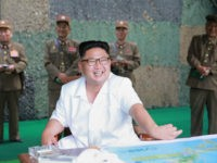 This undated photo released by North Korea's official Korean Central News Agency (KCNA) on July 21, 2016 shows North Korean leader Kim Jong-Un (C) smiling as he visits a drill for ballistic missile launch by the Hwasong artillery units of the Strategic Force of the Korean People's Army. North Korea …
