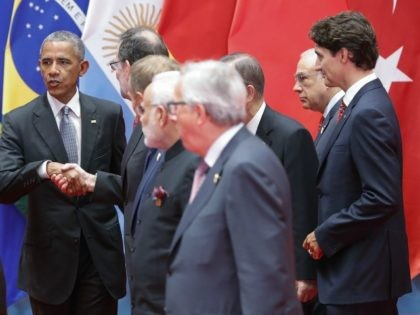 HANGZHOU, CHINA - SEPTEMBER 04: United States President Barack Obama talks to delegates after a group photo at the Hangzhou International Expo Center to the G20 Summit on September 4, 2016 in Hangzhou, China. World leaders are gathering in Hangzhou for the 11th G20 Leaders Summit from September 4 to …