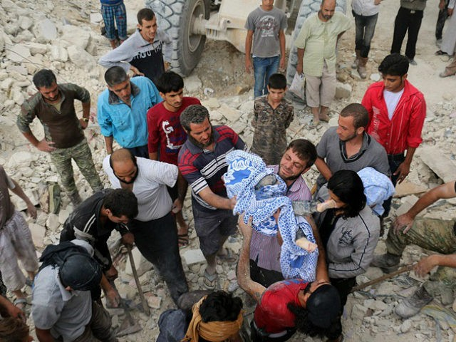 SYRIA, ALEPPO : EDITORS NOTE: Graphic content / Syrians pass the body of child after digging it out from under the rubble of a building following bombardment on the al-Marja neighbourhood of the northern Syrian city of Aleppo on September 23, 2016. Missiles rained down on rebel-held areas of Syria's Aleppo, causing widespread destruction that overwhelmed rescue teams, as the army prepared a ground offensive to retake the city. / AFP PHOTO / AMEER ALHALBI