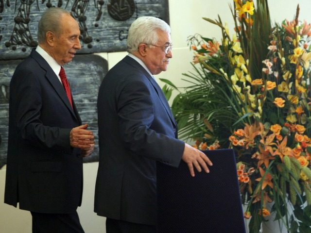 Israeli President Shimon Peres (L) walks with Palestinian Authority President Mahmud Abbas at the end of a joint press conference at the president's residence in Jerusalem on July 22, 2008. Abbas and Peres met to review developments in the peace process between the two sides. AFP PHOTO/MENAHEM KAHANA (Photo credit …