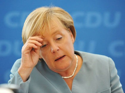 German Chancellor Angela Merkel arrives for a party leadership meeting of the Christian Democratic Union (CDU) in Berlin on August 23, 2010. Chancellor Angela Merkel dismissed angry calls by German business leaders to scrap a planned tax on nuclear energy production which they call a threat to investment. AFP PHOTO …