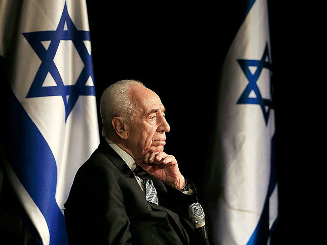 FILE - In this Sunday, July 6, 2014, file photo, Israeli President Shimon Peres talks during a visit in the southern Israeli town of Sderot, Israel. Former Israeli President Shimon Peres on Tuesday, Sept. 13, 2016, suffered a stroke and was rushed to a hospital, where he was sedated and placed on a respirator ahead of a brain scan. (AP Photo/Tsafrir Abayov, File)