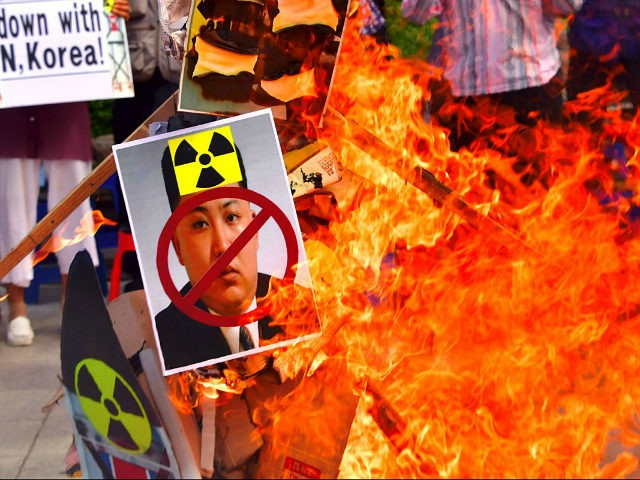 South Korean conservative activists set fire to a portrait of North Korean leader Kim Jong-Un during a protest denouncing North Korea's nuclear test in Seoul on September 10, 2016. South Korean newspapers sounded the alarm on September 10 over what one termed the 'nuclear maniac' Kim Jong-Un, saying the North …