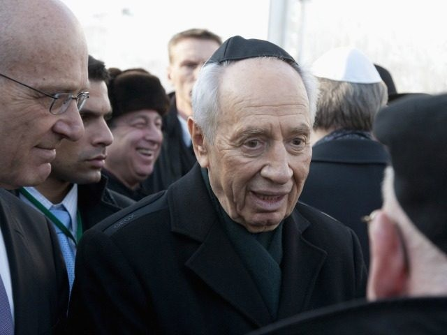 BERLIN - JANUARY 26: Israeli President Shimon Peres commemorates at the memorial track 17 Grunewald of the holocaust victims on January 26, 2010 in Berlin, Germany. Peres is on a official four-day visit to Germany and will address the Bundestag lower house of Parliament. (Photo by Henning Schacht-Pool/Getty Images)