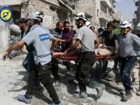 In this photo provided by the Syrian Civil Defense White Helmets, rescue workers work the site of airstrikes in the al-Sakhour neighborhood of the rebel-held part of eastern Aleppo, Syria, Wednesday Sept. 21, 2016. Ibrahim Alhaj, a member of the volunteer first responders known as the Syria Civil Defense, said …