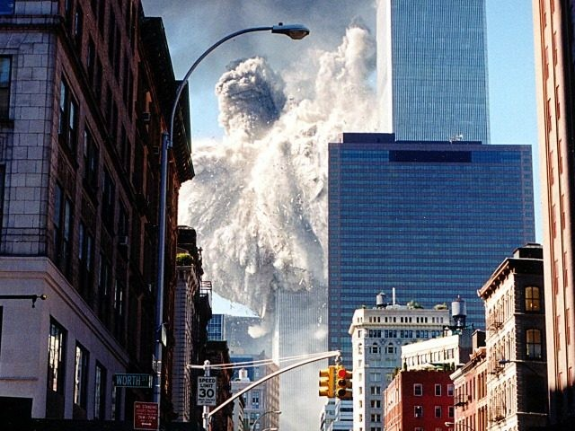 The south tower of the World Trade Center collapses sending dust and smoke into the streets 11 September, 2001, in New York. Two planes crashed into the towers which later collapsed. AFP PHOTO/Aaron MILESTONE (Photo credit should read AARON MILESTONE/AFP/Getty Images)