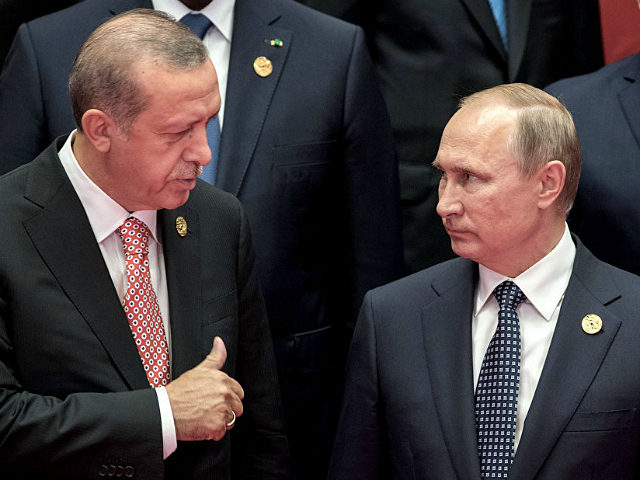 2927724 09/04/2016 September 4, 2016. Russian President Vladimir Putin, right, and Turkish President Recep Erdogan during the group photo session of the heads of G20 nations, invitees and international organizations in Hangzhou. Sergey Guneev/Sputnik via AP