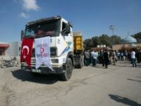 A truck loaded with aid parcels provided by Turkey is parked at the Kerem Shalom crossing near Rafah after it entered the southern Gaza Strip from Israel on July 4, 2016. A Turkish ship carrying aid for Gaza arrived in Israel on July 3, a week after the two countries …
