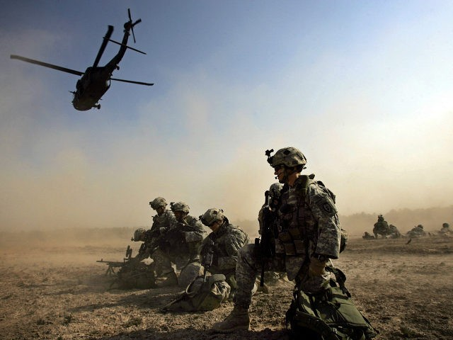 A US soldier from 1-501 Para-Infantry Regiment take up positions moments after dismounting of a Blackhawk helicopter at a drop zone south of Baghdad as part of Operation Gecko, 24 August 2007. Operation Gecko was launched as part of a US military strategy to partner with Iraqi Sunni volunteers, former …