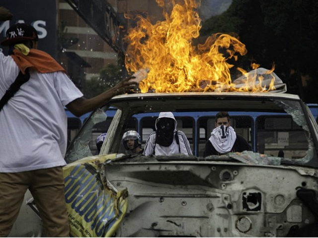 Protesters set a truck on fire on the Francisco Fajardo highway during protests in Caracas, Venezuela, on Thursday, Sept. 1, 2016. Venezuelans took to the streets of Caracas in support of a recall vote against President Nicolas Maduro in the biggest display of discontent with the government's mishandling of the country's economy since a wave of protests in 2014. Photographer: Wil Riera//Bloomberg via Getty Images