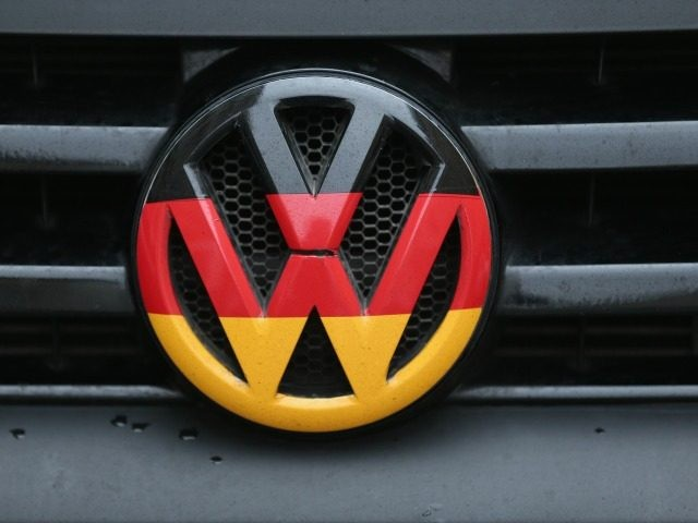 BERLIN, GERMANY - DECEMBER 17: A Volkswagen logo and hood ornament in the colors of the German flag is visible on the front grille of a car on December 17, 2015 in Berlin, Germany. Volkswagen is continuing to struggle with the consequences of its emissions cheating scandal, in which the …