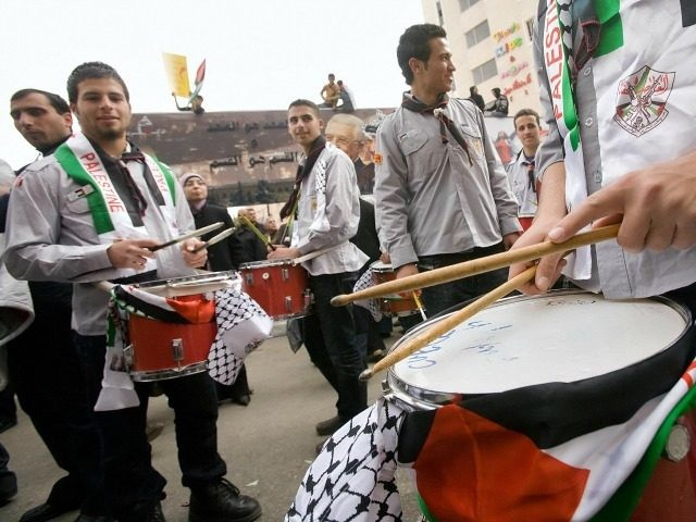 A troop of Boy Scouts play drums as thousands gather in the West Bank city of Ramallah during a demonstration to show their support for the Palestinian Liberation Organization (PLO) and their president Mahmud Abbas, on February 9, 2009. Abbas told journalists in Warsaw he was ready to cooperate with …