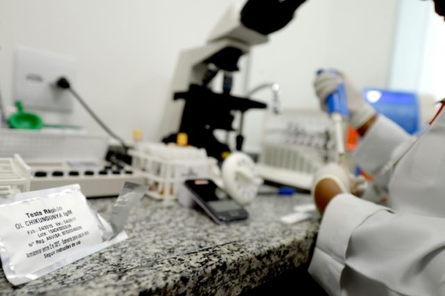 "A lab technician analyses blood samples at the ""Sangue Bom"" (Good Blood) clinic in Rio, testing for Zika and other viruses"