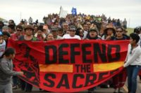 Native Americans marching to a sacred burial ground, disturbed by bulldozers building the Dakota Access Pipeline, near the encampment where hundreds of people have gathered to join the Standing Rock Sioux Tribe's protest of the oil pipeline