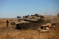 An Israeli tank stationed in the Golan Heights near the Quneitra crossing with Syria