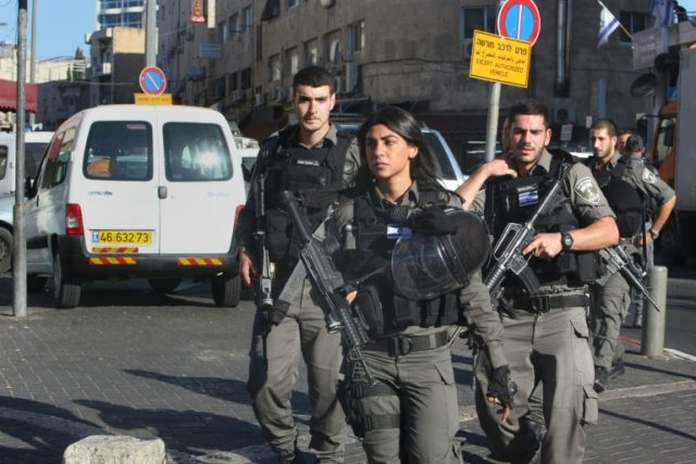 Israeli border police patrol a street following a Palestinian stabbing attack near the Herod's Gate entrance to the Old City of Jerusalem, on September 19, 2016