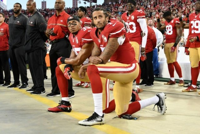 Colin Kaepernick and Eric Reid of the San Francisco 49ers kneel in protest during the national anthem prior to playing the Los Angeles Rams in their NFL game at Levi's Stadium on September 12, 2016 in Santa Clara, California