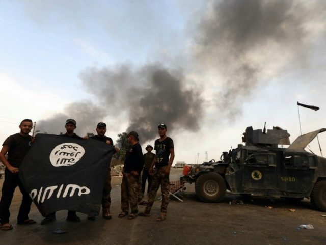 Iraqi forces pushed the Islamic State group out of Qayyarah, considered strategic for a planned offensive against the jihadists' last Iraqi stronghold of Mosul