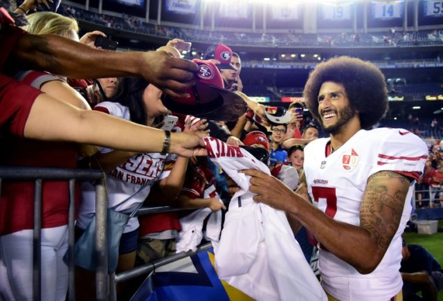 Colin Kaepernick signs autographs for fans after the San Francisco 49ers' 31-21 win over the San Diego Chargers