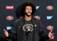 "Colin Kaepernick of the San Francisco 49ers has drawn fierce criticism for refusing to stand during renditions of ""The Star Spangled Banner"""