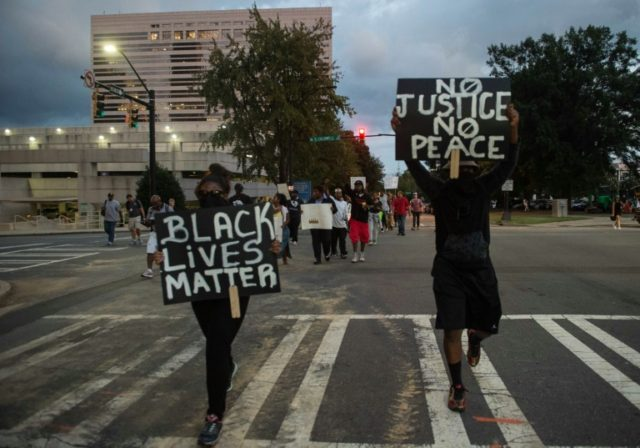 Protesters march during a demonstration against police brutality in Charlotte, North Carolina, on September 21, 2016