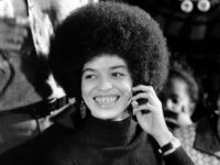 Angela Davis, black Communist jailed for more than a year on murder-conspiracy charges resulting from San Rafael courthouse slaying of a judge and three others, smiles as she talks during an exclusive interview with Associated Press reporters Edith Lederer and Jeannine Yoemans in tiny green interview room at Santa Clara …