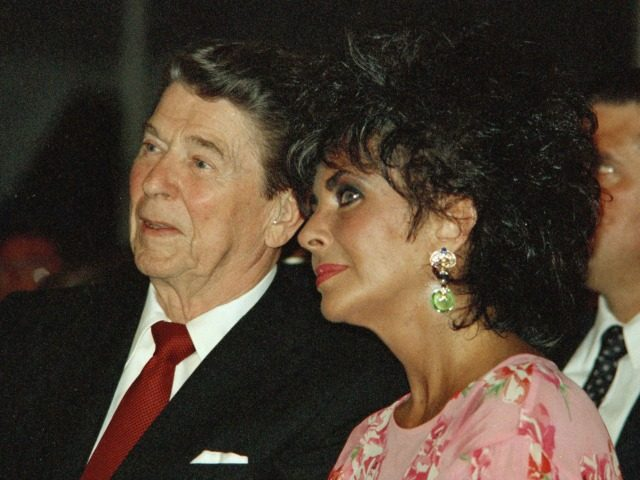 President Reagan sits with actress Elizabeth Taylor during her American Foundation for AIDS Research dinner in Washington on May 31, 1987.