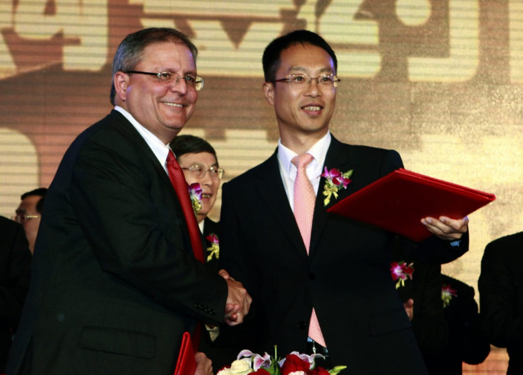 Gerry Lopez, CEO of AMC Entertainment Holdings, left, shakes hands with Zhang Lin, Vice President of Wanda during a signing ceremony for Dalian Wanda Group Co. to acquire AMC Entertainment Holdings in Beijing, China, Monday, May 21, 2012. (AP Photo/Ng Han Guan)